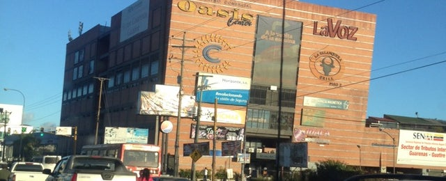 Photo taken at Centro Comercial Oasis Center by Ricardo C. on 2/4/2014